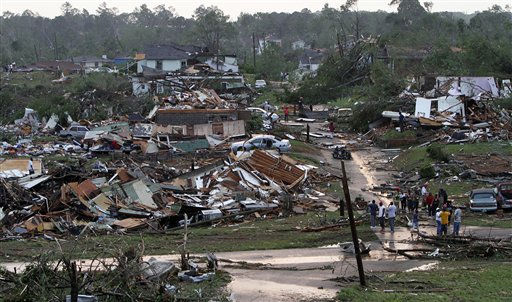 "<div class=""meta ""><span class=""caption-text "">Residents survey the destruction after a tornado hit Pratt City, Ala. just north of downtown Birmingham, Ala. on Wednesday, April 27, 2011. A wave of severe storms laced with tornadoes strafed the South on Wednesday, killing at least 16 people around the region and splintering buildings across swaths of an Alabama university town. (AP Photo/Butch Dill) (AP Photo/ Butch Dill)</span></div>"