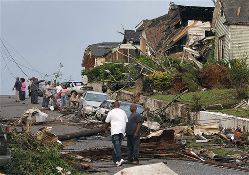 Residents survey the destruction after a tornado hit Pratt City, Ala. just north of downtown Birmingham, Ala., on Wednesday, April 27, 2011. A wave of severe storms laced with tornadoes strafed the South on Wednesday, killing at least 16 people around the region and splintering buildings across swaths of an Alabama university town. &#40;AP Photo&#47;Butch Dill&#41; <span class=meta>(AP Photo&#47; Butch Dill)</span>