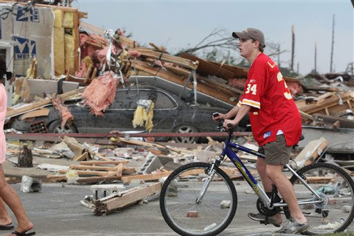 Onlookers make their way through the rubble left by a strong tornado Wednesday, April 27, 2011 Tuscaloosa, Ala. A wave of severe storms laced with tornadoes strafed the South on Wednesday, killing at least 16 people around the region and splintering buildings across swaths of an Alabama university town. &#40;AP Photo&#47;Caroline Summers&#41; <span class=meta>(AP Photo&#47; Caroline Summers)</span>