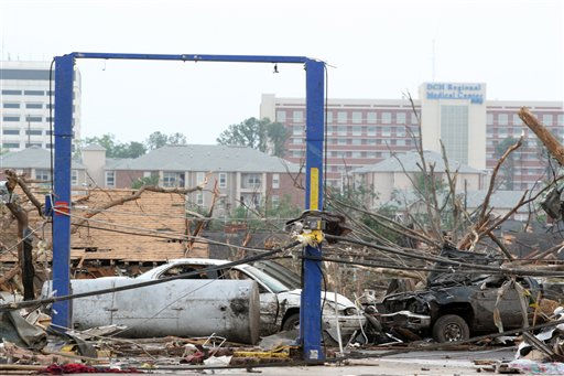 "<div class=""meta ""><span class=""caption-text "">Debris is littered after a tornado hit, Wednesday, April 27, 2011 Tuscaloosa, Ala. A wave of severe storms laced with tornadoes strafed the South on Wednesday, killing at least 16 people around the region and splintering buildings across swaths of an Alabama university town. (AP Photo/Caroline Summers) (AP Photo/ Caroline Summers)</span></div>"