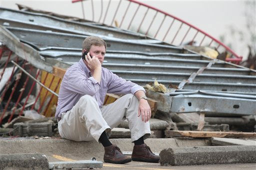 Lee Henderson sits amid the rubble of his Smoothie King store after a tornado ripped through Wednesday, April 27, 2011 Tuscaloosa, Ala. A wave of severe storms laced with tornadoes strafed the South on Wednesday, killing at least 16 people around the region and splintering buildings across swaths of an Alabama university town. &#40;AP Photo&#47;Caroline Summers&#41; <span class=meta>(AP Photo&#47; Caroline Summers)</span>