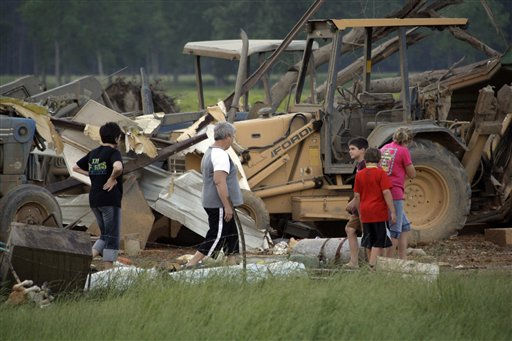 Residents survey the damage to their home near Bond, Miss., Wednesday, April 27, 2011. Several tornadoes hit  in the state resulting in number of deaths. &#40;AP Photo&#47;Rogelio V. Solis&#41; <span class=meta>(AP Photo&#47; Rogelio V. Solis)</span>