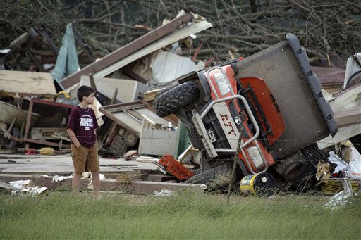 "<div class=""meta image-caption""><div class=""origin-logo origin-image ""><span></span></div><span class=""caption-text"">A young resident surveys the damage to a home near Bond, Miss., Wednesday, April 27, 2011. Several tornadoes hit  in the state resulting in number of deaths. (AP Photo/Rogelio V. Solis) (AP Photo/ Rogelio V. Solis)</span></div>"