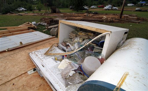 A freezer full of food sits outside the remains of a trailer in Preston, Miss., following a tornado touchdown Wednesday, April 27, 2011, that resulted in the deaths of three related women.   &#40;AP Photo&#47;Rogelio V. Solis&#41; <span class=meta>(AP Photo&#47; Rogelio V. Solis)</span>