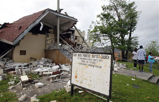 People stand outside the Saint Mary Primitive Baptist Church that was totally destroyed when a tornado hits Pratt City just north of downtown Birmingham on Wednesday, April 27, 2011, in Birmingham, Ala. &#40;AP Photo&#47;Butch Dill&#41; <span class=meta>(AP Photo&#47; Butch Dill)</span>