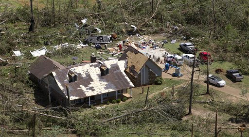 "<div class=""meta image-caption""><div class=""origin-logo origin-image ""><span></span></div><span class=""caption-text"">This is an aerial view of tornado damage in Concord, Ala., Thursday, April 28, 2011. Massive tornadoes tore a town-flattening streak across the South, killing at least 266 people in six states and forcing rescuers to carry some survivors out on makeshift stretchers of splintered debris.  (AP Photo/Dave Martin) (AP Photo/ Dave Martin)</span></div>"