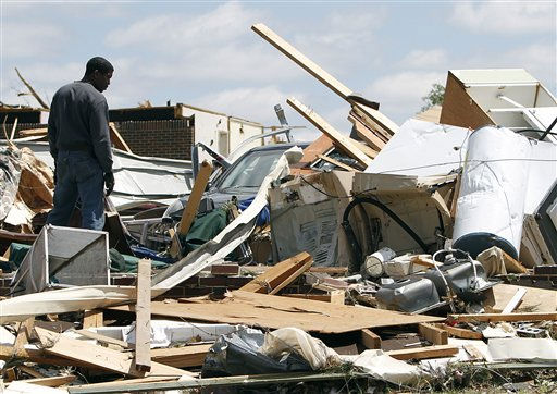 Residents search through what is left of their homes after a tornado hits Pleasant Grove just west of downtown Birmingham yesterday afternoon on Thursday, April 28, 2011, in Birmingham, Ala.  President Barack Obama said he would visit Alabama Friday to view damage and meet with the governor and families devastated by the storms. Obama has already expressed condolences by phone to Gov. Robert Bentley and approved his request for emergency federal assistance. &#40; &#40;AP Photo&#47;Butch Dill&#41; <span class=meta>(AP Photo&#47; Butch Dill)</span>