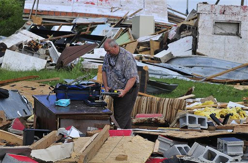 "<div class=""meta image-caption""><div class=""origin-logo origin-image ""><span></span></div><span class=""caption-text"">Randy Hudgins looks through his sons belongings Thursday April 28, 2011, after a tornado hit the Eoline Community near Centreville, Ala., on Wednesday, April 27, 2011. Hudgins' son Randy was in the home when the tornado struck but received only minor injuries.(AP Photo/David Bundy) (AP Photo/ DAVID BUNDY)</span></div>"