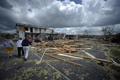 "<div class=""meta image-caption""><div class=""origin-logo origin-image ""><span></span></div><span class=""caption-text"">Debris is spread across the parking lot of an apartment complex from a tornado Thursday, April 28, 2011 in Glade Spring, Va. Several homes and trucks stops along I-81 were severely damaged near I-81. Five deaths have been reported. (AP Photo/Jeff Gentner) (AP Photo/ Jeff Gentner)</span></div>"