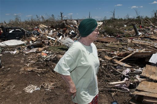 Yvone Engle surveys what is left of her home that she and her husband Elvis Ray Engle, survived the tornado that hit Phil Campbell Thursday April 27, 2011. The two where trapped in their bedroom when the storm hit but both came out with only scrapes. &#40;AP&#47;Bob Farley&#41; <span class=meta>(AP Photo&#47; Bob Farley)</span>