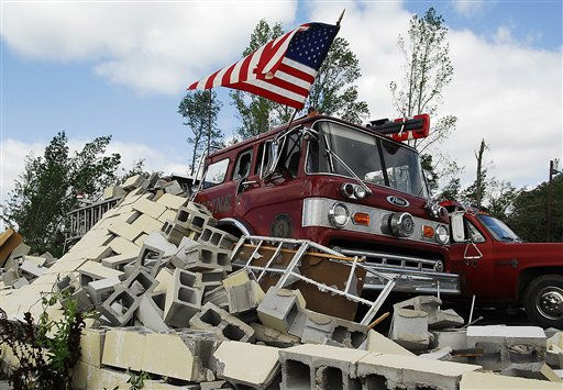 "<div class=""meta image-caption""><div class=""origin-logo origin-image ""><span></span></div><span class=""caption-text"">Debris covers fire trucks at the Eoline Volunteer Fire Department near Centreville, Ala., Thursday, April 28, 2011, where a tornado struck the day before. Massive tornadoes tore a town-flattening streak across the South, killing at least 269 people in six states and forcing rescuers to carry some survivors out on makeshift stretchers of splintered debris. (AP Photo/David Bundy) (AP Photo/ DAVID BUNDY)</span></div>"