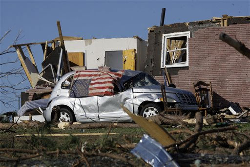 An upside down tattered American flag covers a tornado destroyed vehicle in Phil Campbell, Ala.,Thursday, April 28, 2011. The tornado destroyed much of the small community and caused several deaths. &#40;AP Photo&#47;Rogelio V. Solis&#41; <span class=meta>(AP Photo&#47; Rogelio V. Solis)</span>