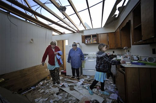 Jo Ann Hill, Linda Parks and Savanna Reynolds, 8, from left, look through Hill&#39;s appartment near I-81 that was destroyed by a tornado Thursday, April 28, 2011 in Glade Spring, Va. Several homes and trucks stops along I-81 were severly damaged. &#40;AP Photo&#47;Jeff Gentner&#41; <span class=meta>(AP Photo&#47; Jeff Gentner)</span>