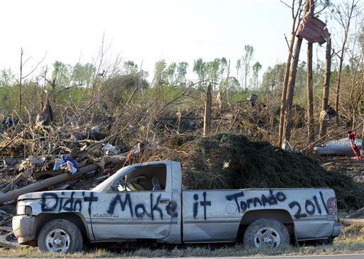 "<div class=""meta image-caption""><div class=""origin-logo origin-image ""><span></span></div><span class=""caption-text"">A damaged truck is covered in graffiti in a tornado-ravaged area near Rainsville, Ala., Thursday, April, 28, 2011.  A least 32 people died when a tornado struck Dekalb County Wednesday.  (AP Photo/ Birmingham News, Mark Almond) ** MAGS OUT NO SALES ** (AP Photo/ MARK ALMOND)</span></div>"