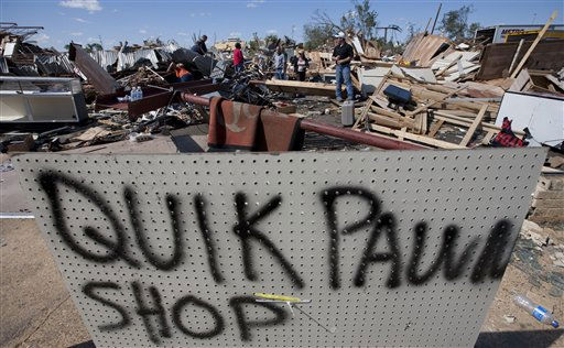 Pawn shop employees search the rubble for missing weapons as they clean up tornado damage in Tuscaloosa, Ala., Thursday, April 28, 2011. &#40;AP Photo&#47;Dave Martin&#41; <span class=meta>(AP Photo&#47; Dave Martin)</span>