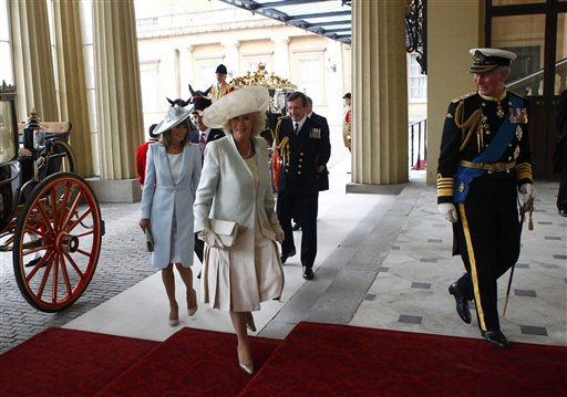 Britain&#39;s Prince Charles, Camilla, Duchess of Cornwall, and Carole Middleton, mother of Catherine, Duchess of Cambridge, arrive at Buckingham Palace after the wedding ceremony of Prince William and Kate Middleton in Westminster Abbey, in central London April 29, 2011. &#40;AP Photo&#47;ANDREW WINNING, Pool&#41; <span class=meta>(AP Photo&#47; ANDREW WINNING)</span>