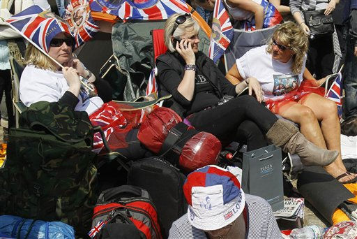 "<div class=""meta image-caption""><div class=""origin-logo origin-image ""><span></span></div><span class=""caption-text"">Royal fans sit on the pavement near Westminster Abbey in London, Thursday, April 28, 2011. Royal  enthusiasts are camping out on the pavement to reserve a spot to watch Prince William and Kate Middleton as they arrive to marry in Westminster Abbey on Friday, April 29. (AP Photo/Kirsty Wigglesworth) (AP Photo/ Kirsty Wigglesworth)</span></div>"
