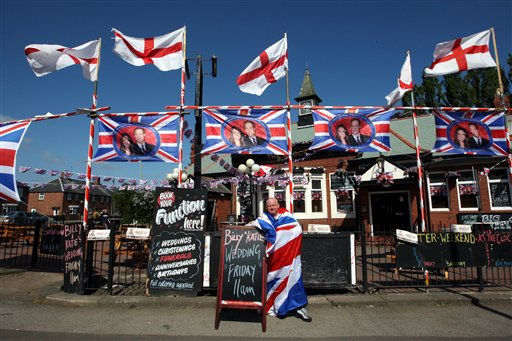 Pub landlord Norman Scott, who run&#39;s The Clock pub, shows off his decorations for the royal wedding of William and Kate tomorrow, in Hebburn England, Thursday, April. 28, 2011.&#40;AP Photo&#47;Scott Heppell&#41;. <span class=meta>(AP Photo&#47; SCOTT HEPPELL)</span>