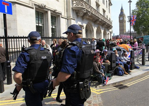 "<div class=""meta image-caption""><div class=""origin-logo origin-image ""><span></span></div><span class=""caption-text"">Armed police officers patrol pass the tents set up by royal supporters queuing to see the royal wedding outside Westminster Abbey in London, Thursday, April 28, 2011. Prince William and Kate Middleton are to marry in Westminster Abbey on Friday, April 29. (AP Photo/Sang Tan) (AP Photo/ Sang Tan)</span></div>"