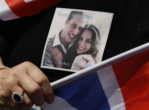A picture of Prince William and Kate Middleton is seen on the T-shirt, and a ring similar to that of Kate Middleton&#39;s engagement ring worn by a royal fan waiting near Westminster Abbey in London, Thursday, April 28, 2011. Royal  enthusiasts are camping out on the pavement to reserve a spot to watch Prince William and Kate Middleton as they arrive to marry in Westminster Abbey on Friday, April 29. &#40;AP Photo&#47;Kirsty Wigglesworth&#41; <span class=meta>(AP Photo&#47; Kirsty Wigglesworth)</span>