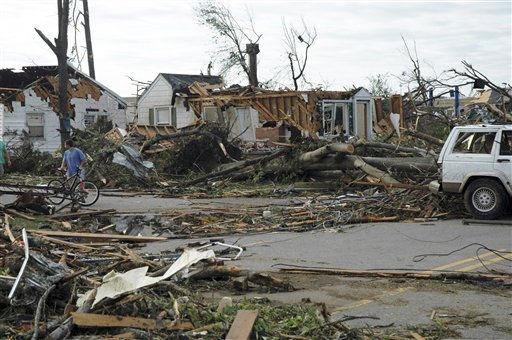 A man pauses to look at damage from a deadly tornado, on Thursday, April 28, 2011, in Tuscaloosa, Ala. The twister demolished a neighborhood and commercial area near the University of Alabama. &#40;AP Photo&#47;Jay Reeves&#41; <span class=meta>(AP Photo&#47; Jay Reeves)</span>