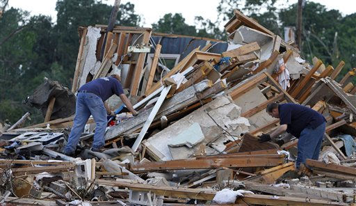 "<div class=""meta ""><span class=""caption-text "">Residents search through what is left of their homes Thursday, April 28, 2011 after a tornado hit Pleasant Grove just west of downtown Birmingham, Ala., Wednesday afternoon. (AP Photo/Butch Dill) (AP Photo/ Butch Dill)</span></div>"