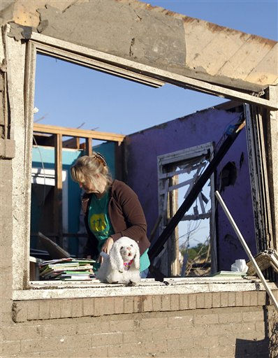 Vicki Wood searches through what is left of her daughter&#39;s home Thursday, April 28, 2011 after a tornado hit Pleasant Grove just west of downtown Birmingham, Ala., Wednesday afternoon. &#40;AP Photo&#47;Butch Dill&#41; <span class=meta>(AP Photo&#47; Butch Dill)</span>