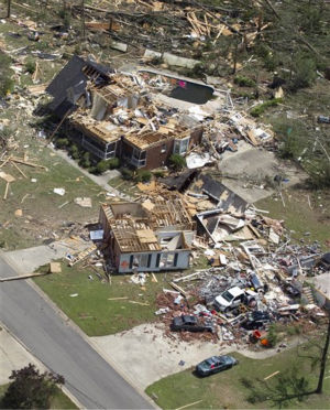 This is an aerial view of tornado damage in Pleasant Grove, Ala., Thursday, April 28, 2011. Massive tornadoes tore a town-flattening streak across the South, killing at least 266 people in six states and forcing rescuers to carry some survivors out on makeshift stretchers of splintered debris.  &#40;AP Photo&#47;Dave Martin&#41; <span class=meta>(AP Photo&#47; Dave Martin)</span>