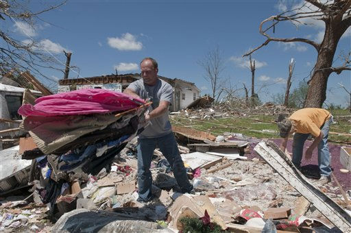 Mark Plunkett, left, with the help of Allen Southerland, right, find some of his wife&#39;s clothing in the debris of his home in Phil Campbell, Ala., Thursday, April 28, 2011. They where not home when the storm hit but at a church up the street. &#40;AP Photo&#47;Bob Farley&#41; <span class=meta>(AP Photo&#47; Bob Farley)</span>