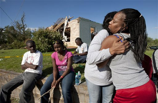 Tuscaloosa resident Valerie Moore, second from right, is embraced by a neighbor as they wait for help near her tornado damaged home in Tuscaloosa, Ala., Thursday, April 28, 2011. &#40;AP Photo&#47;Dave Martin&#41; <span class=meta>(AP Photo&#47; Dave Martin)</span>