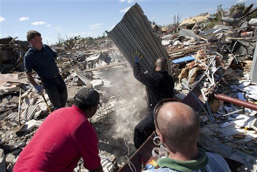 "<div class=""meta image-caption""><div class=""origin-logo origin-image ""><span></span></div><span class=""caption-text"">Pawn shop employees search the rubble for missing weapons as they clean up tornado damage in Tuscaloosa, Ala., Thursday, April 28, 2011. (AP Photo/Dave Martin) (AP Photo/ Dave Martin)</span></div>"