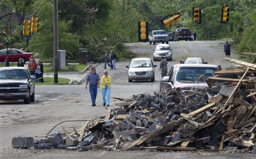 Residents walk near the debris in downtown Cullman, Ala., Thursday, April 28, 2011. Tornadoes left over 200 people dead in a spree that swept across six states on Wednesday. &#40;AP Photo&#47;Dave Martin&#41; <span class=meta>(AP Photo&#47; Dave Martin)</span>