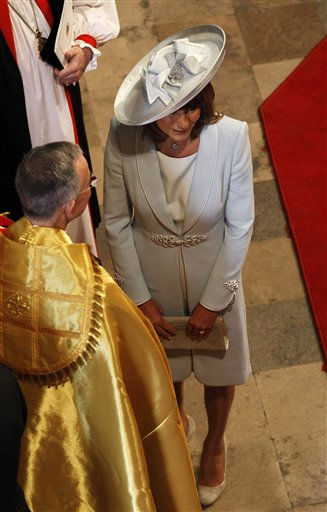"<div class=""meta ""><span class=""caption-text "">Carole Mikkleton, mother of Kate Middleton, speaks to Dean of Westminster John Hall before the wedding of Britain's Prince William and Kate Middleton, in central London April 29, 2011. (AP Photo/Suzanne Plunkett/Pool) (AP Photo/ SUZANNE PLUNKETT)</span></div>"