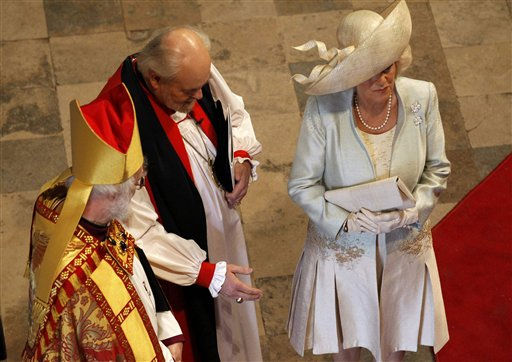 From left, Archbishop of Canterbury Rowan Williams, Bishop of London Richard Chartres and Britain&#39;s Camilla, Duchess of Cornwall, arrive at Westminster Abbey before the wedding of Britain&#39;s Prince William and Kate Middleton in central London April 29, 2011. &#40;AP Photo&#47;Suzanne Plunkett&#47;Pool&#41; <span class=meta>(AP Photo&#47; SUZANNE PLUNKETT)</span>
