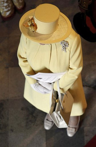 Britain&#39;s Queen Elizabeth stands inside the Westminster Abbey at the end of the wedding ceremony of Britain&#39;s Prince William and his wife Catherine, Duchess of Cambridge, in central London April 29, 2011. &#40;AP Photo&#47;SUZANNE PLUNKETT, Pool&#41; <span class=meta>(Photo&#47;SUZANNE PLUNKETT)</span>