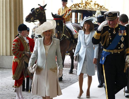 "<div class=""meta ""><span class=""caption-text "">Britain's Prince Charles, right, and his wife Camilla, Duchess of Cornwall, second left, arrive at Buckingham Palace followed by Carole Middleton, center, after the wedding ceremony of Britain's Prince William and Catherine, Duchess of Cambridge, in central London April 29, 2011. (AP Photo/ANDREW WINNING, Pool) (Photo/ANDREW WINNING)</span></div>"