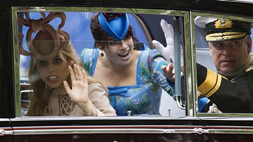 Britain&#39;s Prince Andrew, the Duke of York, and his daughters princesses Beatrice &#40;L&#41; and Eugenie &#40;C&#41; wave as they travel along the Processional Route to Buckingham Palace after the wedding ceremony of Britain&#39;s Prince William and Kate, Duchess of Cambridge, in London, on April 29, 2011. &#40;AP Photo&#47;Warren Allott, Pool&#41; <span class=meta>(Photo&#47;Warren Allott)</span>