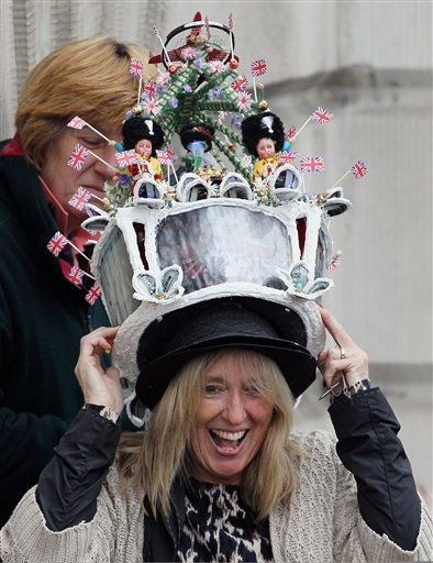 "<div class=""meta ""><span class=""caption-text "">A reveler laughs as she tries on a hat before the Royal Wedding of Prince William to Catherine Middleton at Westminster Abbey on April 29, 2011 in London. (AP Photo/Matt Cardy, Pool) (Photo/Matt Cardy)</span></div>"