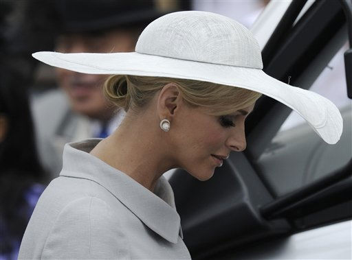 Former South African swimmer Charlene Wittstock, fiancee of Prince Albert of Monaco leaves Westminster Abbey after the wedding service at the Royal Wedding in London Friday, April 29, 2011. &#40;AP Photo&#47;Martin Meissner&#41; <span class=meta>(AP Photo&#47; Martin Meissner)</span>