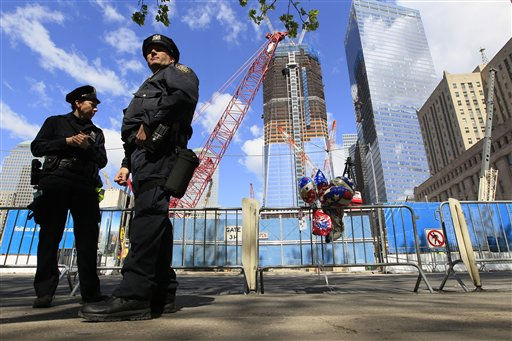 New York City police officers stand guard outside ground zero ahead of President Barack Obama&#39;s visit, Thursday, May 5, 2011 in New York.  Obama has arrived in New York for a solemn visit to Ground Zero where he will try to bury the memory of Osama bin Laden by honoring those who died in the Sept. 11 attacks on the World Trade Center.  <span class=meta>(AP Photo&#47; Mary Altaffer)</span>