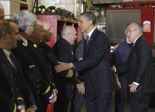President Barack Obama and former New York City Mayor Rudy Giuliani, right, meet with firefighters and first responders at Engine 54, Ladder 4, Battalion 9 before visiting the National Sept. 11 Memorial at Ground Zero in New York, Thursday, May 5, 2011.  <span class=meta>(AP Photo&#47; Charles Dharapak)</span>