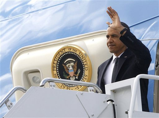 President Barack Obama waves as he steps off Air Force One at John F. Kennedy International Airport in New York, Thursday, May 5, 2011, en route to Ground Zero and meet with first responders and family members of victims of the Sept. 11, 2001 attacks after he announced Sunday that Osama bin Laden had been killed by U.S. forces. <span class=meta>(AP Photo&#47; Charles Dharapak)</span>