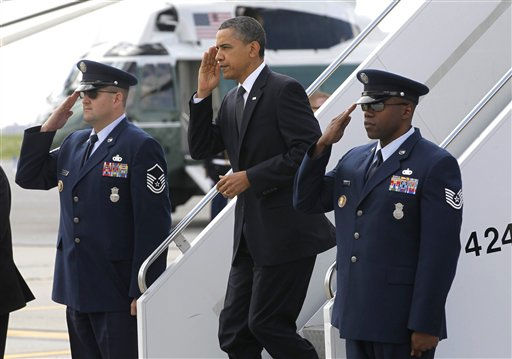 "<div class=""meta image-caption""><div class=""origin-logo origin-image ""><span></span></div><span class=""caption-text"">President Barack Obama steps off Air Force One at John F. Kennedy International Airport in New York, Thursday, May 5, 2011, en route to Ground Zero and meet with first responders and family members of victims of the Sept. 11, 2001 attacks after he announced Sunday that Osama bin Laden had been killed by U.S. forces.  (AP Photo/ Charles Dharapak)</span></div>"