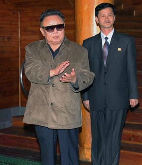 In this undated photo released by Korean Central News Agency via Korea News Service in Tokyo Monday, May 9, 2011, North Korean leader Kim Jong Il, wearing glasses, visits a swimming pool at the Namhung youth chemical complex in Anju, North Korea. The man in the background is unidentified. &#40;AP Photo&#47;Korean Central News Agency via Korea News Service&#41; JAPAN OUT UNTIL 14 DAYS AFTER THE DAY OF TRANSMISSION <span class=meta>(AP Photo&#47; HK**TOK**)</span>