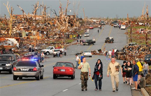 Residents of Joplin, Mo, walk west on 26th Street near Maiden Lane after a tornado hit the southwest Missouri city on Sunday evening, May 22, 2011. The tornado tore a path a mile wide and four miles long destroying homes and businesses. &#40;AP Photo&#47;Mike Gullett&#41; <span class=meta>(AP Photo&#47; Mike Gullett)</span>
