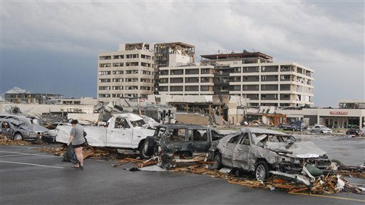 "<div class=""meta ""><span class=""caption-text "">Damaged vehicles litter the parking lot of St. John's Hospital in Joplin, Mo, after a tornado hit the southwest Missouri city on Sunday evening, May 22, 2011. A massive tornado blasted its way across southwestern Missouri on Sunday, flattening several blocks of homes and businesses in Joplin and leaving residents frantically scrambling through the wreckage. (AP Photo/Mike Gullett) (AP Photo/ Mike Gullett)</span></div>"