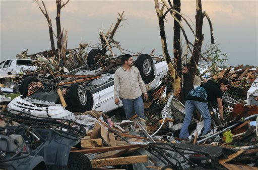 Residents begin digging through the rubble of their home after it was destroyed by a tornado that hit Joplin, Mo. on Sunday evening, May 22, 2011. The tornado tore a path a mile wide and four miles long destroying homes and businesses. &#40;AP Photo&#47;Mike Gullett&#41; <span class=meta>(AP Photo&#47; MIKE GULLETT)</span>