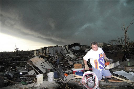 Mark Siler carries some salvageable items from the house of his friend Clay Warden as another storm approaches Joplin, Mo. on Monday, May 23, 2011. Warden&#39;s house was destroyed on Sunday by a tornado that hit the southwest Missouri town. &#40;AP Photo&#47;Mike Gullett&#41; <span class=meta>(AP Photo&#47; MIKE GULLETT)</span>
