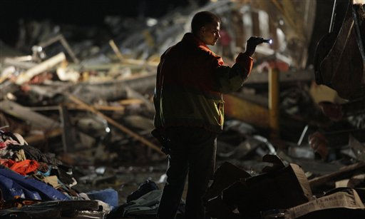 "<div class=""meta ""><span class=""caption-text "">An emergency worker searches a Walmart store that was severely damaged by a tornado in Joplin, Mo., Sunday, May 22, 2011. A large tornado moved through much of the city, damaging a hospital and hundreds of homes and businesses. (AP Photo/Charlie Riedel) (AP Photo/ Charlie Riedel)</span></div>"