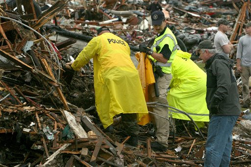 Emergency personnel excavate a body from the wreckage of a home near the St. John&#39;s Regional Medical Center in Joplin, Mo., Monday, May 23, 2011. A destructive tornado moved through the city on Sunday evening, killing at least 89 people and injuring hundreds more.   <span class=meta>(AP Photo&#47;Mark Schiefelbein)</span>